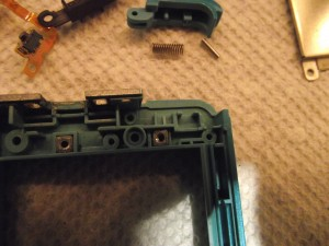 Make sure these two nuts are in there. The four screws on the battery cover screw into these.